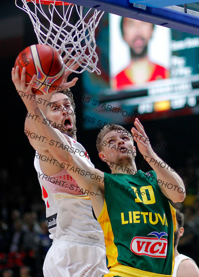 Spain's Pau Gasol (L) vies with Lithuania's Renaldas Seibutis (R) during European championship basketball final match between Spain and Lithuania on September 20, 2015 in Lille, France  (credit image & photo: Pedja Milosavljevic / STARSPORT)