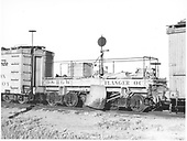 Side view of D&amp;RGW flanger #OC between outfit boxcars at Alamosa.<br /> D&amp;RGW  Alamosa, CO  Taken by Richardson, Robert W. - 1946