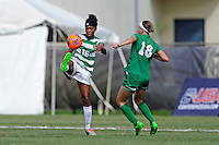 8 November 2015:  North Texas Forward Rachel Holden (16) attempts to control the ball with Marshall Defender/Midfielder Taylor Fleming (18) approaching in the second half as the University of North Texas Mean Green defeated the Marshall University Thundering Herd, 1-0, in the Conference USA championship game at University Park Stadium in Miami, Florida.