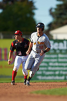 West Virginia Black Bears Chris Harvey (10) running the bases past second baseman Mike Garzillo (11) during a game against the Batavia Muckdogs on August 21, 2016 at Dwyer Stadium in Batavia, New York.  West Virginia defeated Batavia 6-5.  (Mike Janes/Four Seam Images)