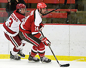 Michael Del Mauro (Harvard - 13), Nic Vangog (St. Lawrence - 14) - The Harvard University Crimson defeated the St. Lawrence University Saints 4-3 on senior night Saturday, February 26, 2011, at Bright Hockey Center in Cambridge, Massachusetts.