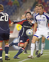 New England Revolution defender Jay Heaps (6) on a forward run is in the mix with Kansas City Wizards defender Tyson Wahl (20). The Kansas City Wizards defeated the New England Revolution, 3-1, in Gillette Stadium on October 25, 2008. Photo by Andrew Katsampes/isiphotos.com