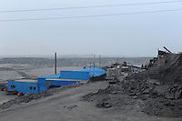 The Bayan Obo mine in Inner Mongolia is the home to world's largest deposit of 'rare earth' and the world's largest mine for rare earth, that produces some 70% of the world's rare earth. Rare earths are a class of 17 elements essential for high tech industrial purposes from hard-discs to smart bombs and are essential for most green technology such as wind turbines and re-chargable car batteries. China produces 97% of the world's rare earths..FILE PHOTO-DEC 2009