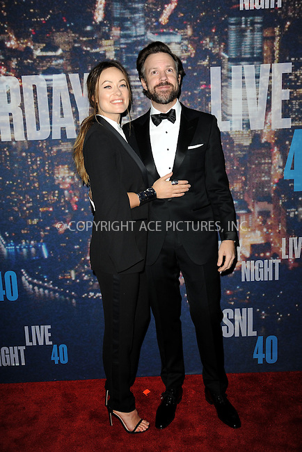 WWW.ACEPIXS.COM<br /> February 15, 2015 New York City<br /> <br /> Jason Sudeikis and Olivia Wilde walking the red carpet at the SNL 40th Anniversary Special at 30 Rockefeller Plaza on February 15, 2015 in New York City.<br /> <br /> Please byline: Kristin Callahan/AcePictures<br /> <br /> ACEPIXS.COM<br /> <br /> Tel: (646) 769 0430<br /> e-mail: info@acepixs.com<br /> web: http://www.acepixs.com