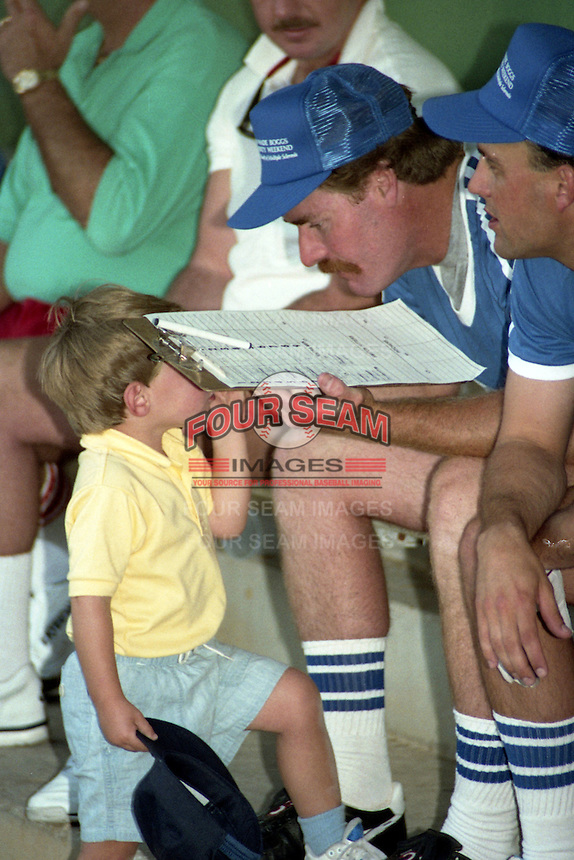 Wade Boggs talks with his son during the 1989 Wade Boggs Celebrity Weekend to benefit multiple sclerosis at Al Lang Stadium in St. Petersburg, Florida.  (MJA/Four Seam Images)