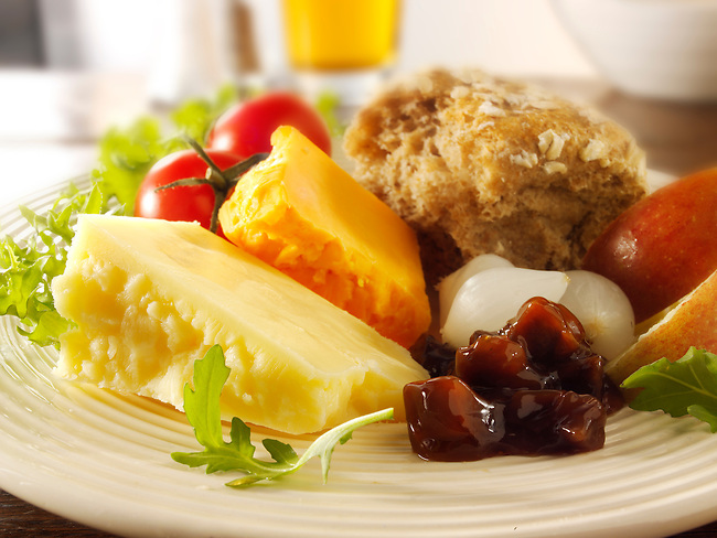 Traditional cheese Ploughman's lunch with Cheddar, and Lancashire cheese photos.