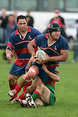 Ardmore Marist prop R. Fua'aletoelau is tackled by a Waiuku defender as J. Fonokolafi looks to provide assistance. Counties Manukau Premier Club Rugby, Ardmore Marist vs Waiuku played at Bruce Pulman Park, Papakura on the 29th of April 2006. Ardmore Marist won 10 - 9.