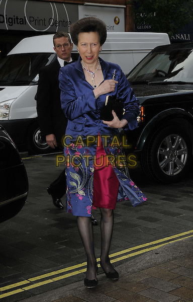 HRH Princess Royal.attended the Natwest UK Fashion & Textile Awards 2013, One Mayfair, North Audley St., London, England, UK, 23rd May 2013..full length  Anne royalty navy blue coat embroidered security  red pink dress black tights patterned clutch bag .CAP/CAN.©Can Nguyen/Capital Pictures.