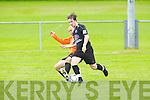 Park's Peter Williams tackles Tralee Dynamos Adam Pigott at Cahermoneen, Tralee on Sunday.