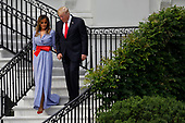 U.S. President Donald Trump and First Lady Melania Trump attend a picnic for military families in Washington, D.C., U.S., on Wednesday, July 4, 2018. Dozens of retired military and national security officers joined the NAACP and the American Medical Association in urging a federal appeals court to uphold a court order blocking Trump's ban on transgender people serving in the military. <br /> Credit: Yuri Gripas / Pool via CNP