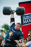 HAINAN ISLAND, CHINA - AUGUST 24:  Zydrunas Savickas of Lithuania competes at the Circus Medley event during the World's Strongest Man competition at Yalong Bay Cultural Square on August 24, 2013 in Hainan Island, China.  Photo by Victor Fraile