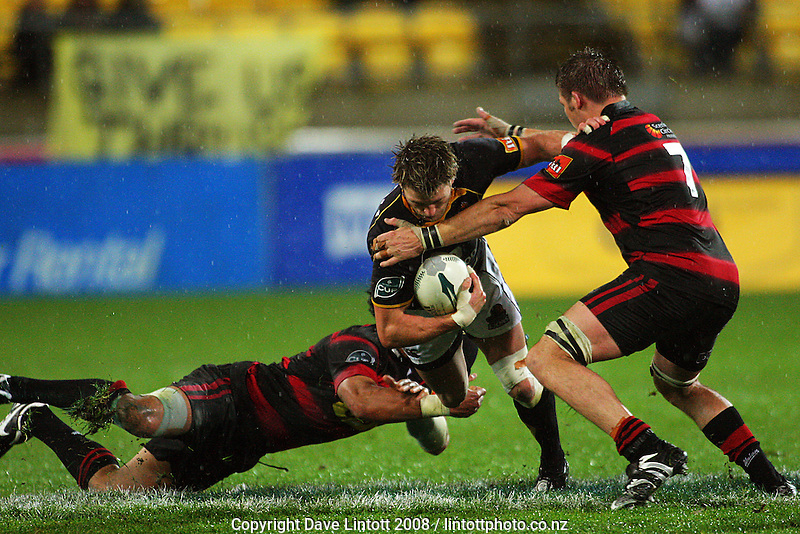 Casey Laulala and Richie McCaw combine to stop Cory Jane during the Air NZ Cup Final between Wellington and Canterbury at Westpac Stadium, Wellington, New Zealand on Saturday 25th October 2008.  Photo: Dave Lintott / lintottphoto.co.nz