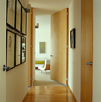 A corridor opens into one of several bedrooms