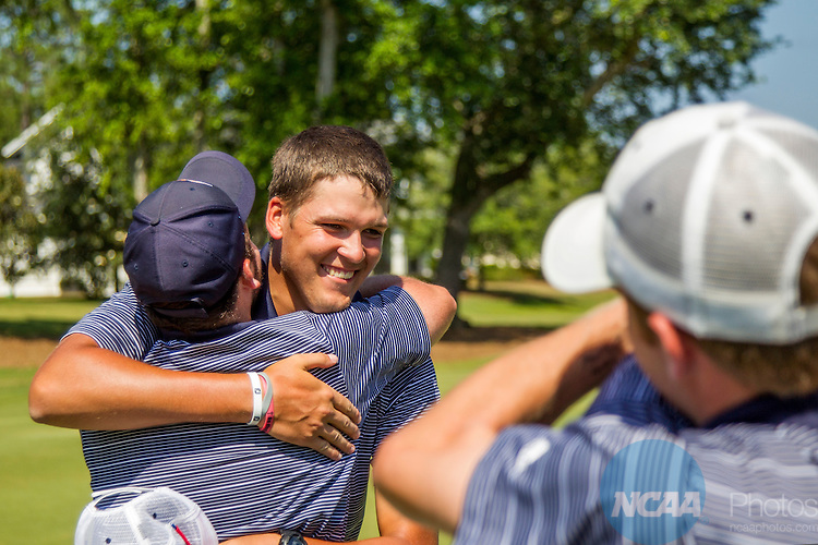 17 MAY 2013:  Buddy Hallman, with the University of Texas at Tyler, hugs teammates on the 18th green after the Patriots won the Division III Men's Golf Championship held at the Sandestin Golf and Beach Resort Raven Course in Destin, FL.  Mark Wallheiser/NCAA Photos