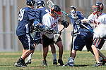 Beverly Hills, CA 04/12/10 - Kenneth Patricia (Loyola # 28) and unidentified Beverly Hills player in action during the Loyola-Beverly Hills Boys Varsity Lacrosse game at Beverly Hills High School, Loyola defeated Beverly Hills 16-0.