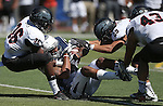 Nevada's Hasaan Henderson (12) is tackled by Southern Utah's LeShaun Sims (36) and Michael Byrd (29) during the second half of an NCAA college football game on Saturday, Aug. 30, 2014 in Reno, Nev. Nevada defeated Southern Utah 28-19. (AP Photo/Cathleen Allison)