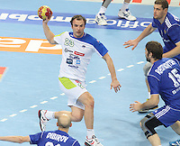 12.01.2013 Barcelona, Spain. IHF men's world championship, Quarter-Final. Picture show Uros Zorman   in action during game between Russia vs Slovenia at Palau ST Jordi