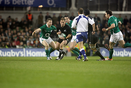 20.11.2010 International Rugby Union from Landsdowne Road Dublin. Ireland v New Zealand. Andy Ellis in possesion for New Zealand with Irelands Gordon D'Arcy, Jonathan Sexton and David Wallace.