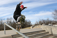 Josh Johnson practices Monday, January 13, 2020, a board slide on a rail at the skateboard park at Walker Park in Fayetteville. Walker Park was the second park added to the city parks system in 1949. The National Weather Service is calling for high temperatures in the 60s this week with a chance of rain after Wednesday. Check out nwaonline.com/200114Daily/ and nwadg.com/photos for today's photo gallery.<br /> (NWA Democrat-Gazette/David Gottschalk)