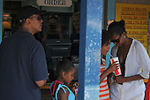 Oak Bluffs, MA - August 26, 2009 -- United States President Barack Obama his daughters Sasha and Malia and wife Michelle stop to pick up a a take-out lunch of fried seafood at Nancy's Restaurant in Oak Bluffs, Massachusetts on the island of Martha's Vineyard, Wednesday, August 26, 2009.  .Credit: Neal Hamberg - Pool via CNP
