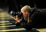 12 December 2010: Photographer Courtney Adams at work during a game between the University of Vermont Catamounts and the Marist College Red Foxes at Patrick Gymnasium in Burlington, Vermont. The Catamounts (7-2) defeated the Red Foxes 75-67 notching their 7th win of the season, and their best start since the '63-'64 season. Mandatory Credit: Ed Wolfstein Photo