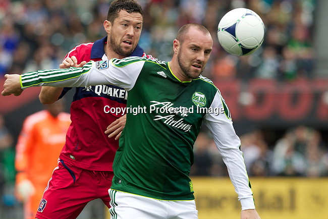 PORTLAND, OR - MAY 20: Portland Timbers forward Kris Boyd (9) heads ball vs. Chicago Fire at JELD-WEN Field on May 20, 2012.  (Steve Dipaola/Portland Timbers)