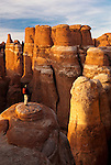 A hiker surveys the view of the Fiery Furnace hoodoos in Arches National Park, Utah.