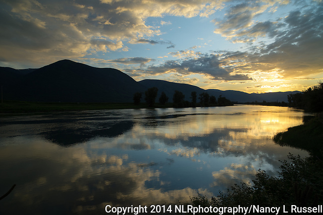 Clouds reflecting on the Kootenai river near Copeland, Idaho