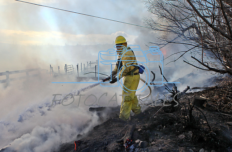 Firefighters battle a 2,000-acre brush fire in south Reno, Nev., on Friday, Nov. 18, 2011..Photo by Cathleen Allison