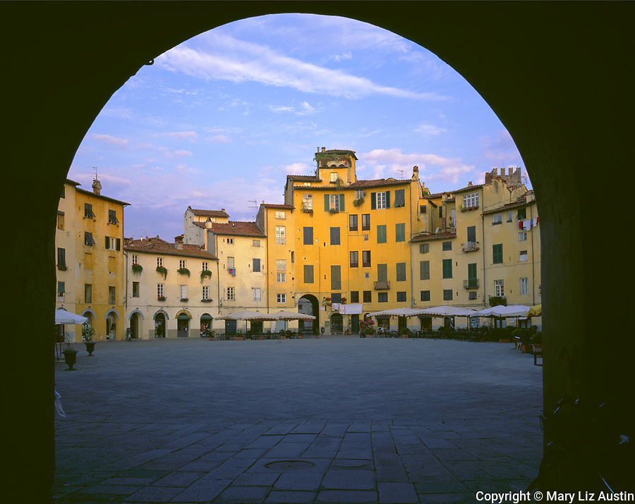 Tuscany, Italy<br /> An archway frames the Piazza Anfiteatro in early morning light in the town of Lucca