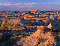 NDTR_123 - USA, North Dakota, Theodore Roosevelt National Park, Evening light defines eroded, sedimentary hills and grassy plains in autumn, Painted Canyon Overlook, South Unit.