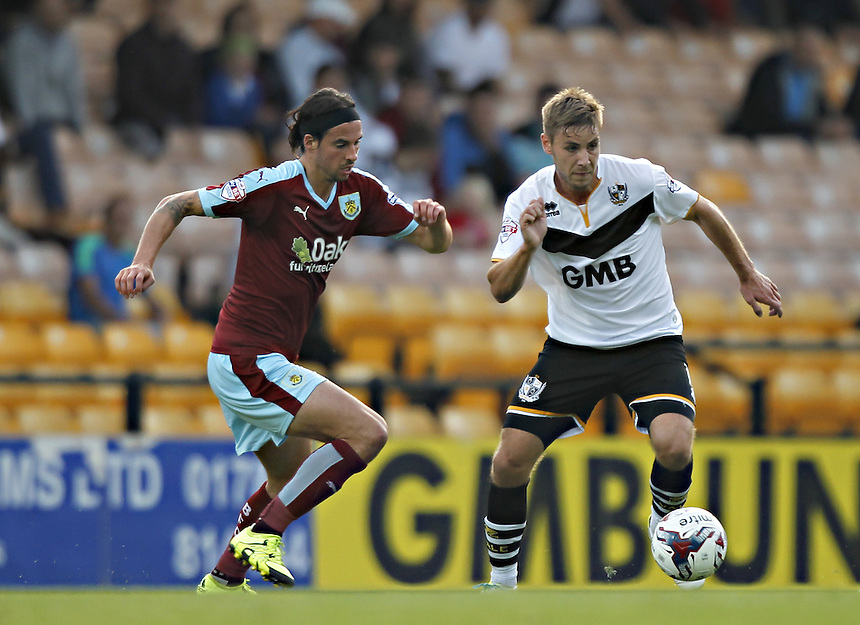 Burnley's George Boyd in action during todays match  with Port Vale's Sam Foley<br /><br />Photographer Mick Walker/CameraSport<br /><br />Football - Capital One Cup First Round - Port Vale v Burnley - Tuesday 11th August 2015 - Vale Park - Burslem<br /> <br />&copy; CameraSport - 43 Linden Ave. Countesthorpe. Leicester. England. LE8 5PG - Tel: +44 (0) 116 277 4147 - admin@camerasport.com - www.camerasport.com