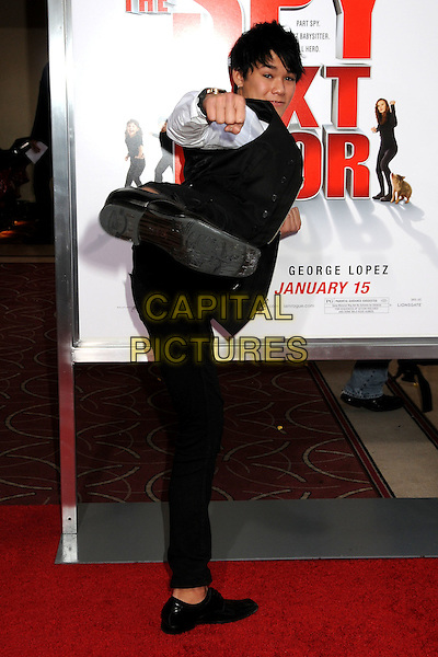 "BOOBOO STEWART.""The Spy Next Door"" Los Angeles Premiere held at The Grove,  Los Angeles, California, USA, .9th January 2010..full length black leg high kicking kick punch karate pose .CAP/ADM/BP.©Byron Purvis/Admedia/Capital Pictures"