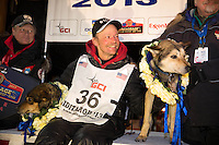 Mitch Seavey with his lead dogs Tanner, left, and Taurus after arriving in Nome first and winning his second Iditarod seld dog race on Tuesday March 12, 2013. Seavey made the journey from Willow in 9 days, 7 hours, 39 minutes, 56 seconds. ..Iditarod Sled Dog Race 2013..Photo by Jeff Schultz copyright 2013 DO NOT REPRODUCE WITHOUT PERMISSION