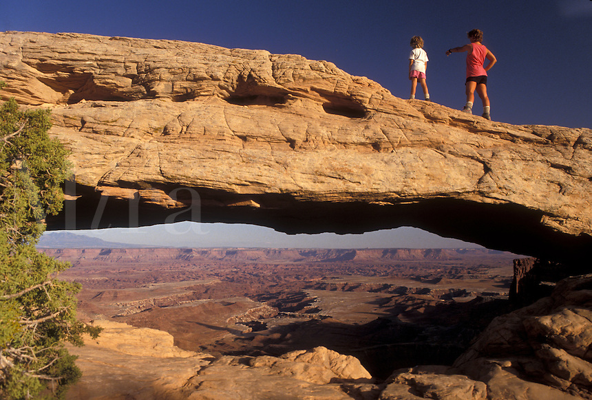 AJ3853, Canyonlands, Canyonlands National Park, Utah, Mother and daughter (6 years old) stand on top of Mesa Arch a natural rock formation in Canyonlands Nat'l Park in the state of Utah.