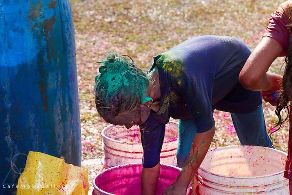 Phagwa or Holi - girl bending over a pot of pink dye - Felicity