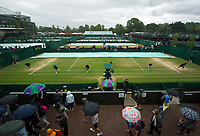 A general view of the covers being put on the outside courts on a rain delayed Day 8<br /> <br /> Photographer Ashley Western/CameraSport<br /> <br /> Wimbledon Lawn Tennis Championships - Day 8 - Tuesday 11th July 2017 -  All England Lawn Tennis and Croquet Club - Wimbledon - London - England<br /> <br /> World Copyright &copy; 2017 CameraSport. All rights reserved. 43 Linden Ave. Countesthorpe. Leicester. England. LE8 5PG - Tel: +44 (0) 116 277 4147 - admin@camerasport.com - www.camerasport.com