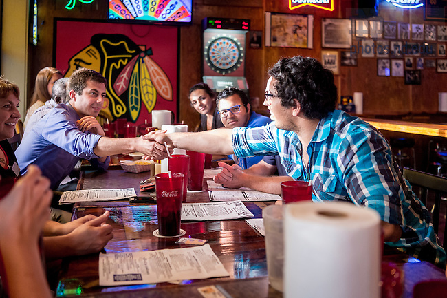 August 16, 2016; South Bend Mayor Pete Buttigieg greets graduate students at dinner at C.J.'s Pub in downtown South Bend during Graduate School Orientation 2016. (Photo by Matt Cashore/University of Notre Dame)