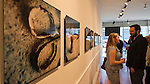 May 4, 2013 - Huntington, New York, U.S. - Sandy exhibit photographs, at left, are by artist Sandra Carrion, at the Opening Reception at fotofoto Gallery, a cooperative photography gallery which is a non-profit organization. The photographs shown are of her friend's father's tools ruined by Hurricane Sandy's devastation.