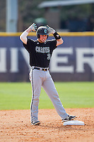 John McNulty (30) of the Coastal Carolina Chanticleers signals to his teammates after hitting a double against the High Point Panthers at Willard Stadium on March 15, 2014 in High Point, North Carolina.  The Chanticleers defeated the Panthers 1-0 in the first game of a double-header.  (Brian Westerholt/Four Seam Images)