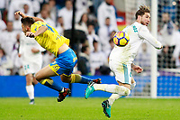 Real Madrid's Sergio Ramos (r) and UD Las Palmas' Jonathan Calleri during La Liga match. November 5,2017. (ALTERPHOTOS/Acero)