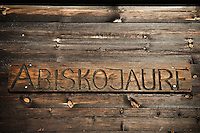 Wooden sign on side of Abiskojaure hut, Kungsleden trail, Lapland, Sweden