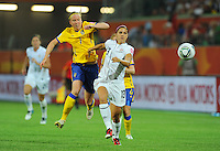 Alex Morgan (r) of team USA and Sara Larsson of team Sweden during the FIFA Women's World Cup at the FIFA Stadium in Wolfsburg, Germany on July 6thd, 2011.