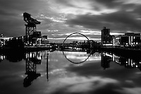 The Finnieston Crane and the Clyde Arc (Squinty Bridge) crossing the River Clyde at Pacific Quay, Glasgow