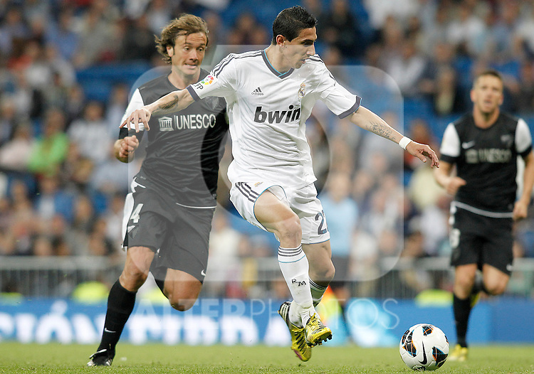 Real Madrid's Angel Di Maria (r) and Malaga's Diego Alfredo Lugano during La Liga match.May 08,2013. (ALTERPHOTOS/Acero)