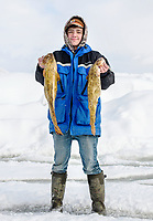 Gavan Grey holds two eel pout fish weighing 5.88 and 4.96 pounds during the eel pout weigh-in on the final day of the 39th Annual International Eelpout Festival, at Leech Lake in Walker, Minnesota, February 25, 2018. Crowds that are more than 10 times the population of tiny Walker, Minn. (pop. 1,069) gather on Minnesota&rsquo;s third largest lake (112,000-acres), Leech Lake, for a festival named for one of the ugliest bottom-dwelling fish, the eelpout.<br /> <br /> Photo by Matt Nager