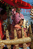 Almost every Burmese child, male or female, spends some time, however short in a monastery or convent and, before they enter one for the first time, they take part in an elaborate initiation ceremony in which they and one of their parents dress up in extravagant costumes, wear a great deal of make-up and ride in highly decorated bullock carts.