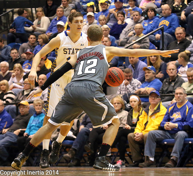 BROOKINGS, SD - JANUARY 18:  Brayden Carlson #12 from South Dakota State University brings the ball upcourt against the defense of Caleb Steffensmeier #12 from Omaha in the first half of their Summit League game Saturday afternoon at Frost Arena in Brookings. (Photo by Dave Eggen/Inertia)