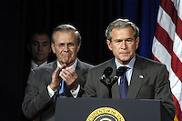 031124-D-2987S-058<br /> Secretary of Defense Donald H. Rumsfeld applauds President George W. Bush during his remarks prior to signing the National Defense Authorization Act at the Pentagon on Nov. 24, 2003.  The Act provides $401.3 billion for the Department of Defense, which will allow for continued support of the missions of the U.S. Military and its men and women serving around the globe.  DoD photo by Helene C. Stikkel (Released)