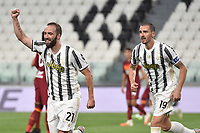 Gonzalo Higuain of Juventus celebrates with Leonardo Bonucci after scoring a goal during the Serie A football match between Juventus FC and AS Roma at Juventus stadium in Turin (Italy), August 1st, 2020. Play resumes behind closed doors following the outbreak of the coronavirus disease. Photo Andrea Staccioli / Insidefoto